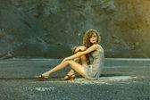 Girl fashion posing on a rock — Stock Photo