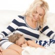 Royalty-Free Stock Photo: Happy mother and sleeping girl
