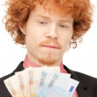 Handsome man with euro cash money - Stock Photo