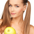 Young beautiful woman with green apple - Stok fotoraf