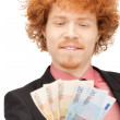 Handsome man with euro cash money — Stock Photo #5403281