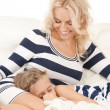 Happy mother and sleeping girl — Stock Photo
