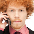 Handsome man with cell phone — Stock Photo #5418236