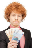 Handsome man with euro cash money — Stockfoto