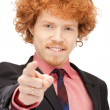 Businessman pointing his finger — Stock Photo #5429861