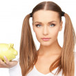 Lovely woman with piggy bank — Stock Photo #5429877
