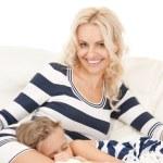 Happy mother and sleeping girl — Stock Photo #5471391