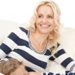 Happy mother and sleeping girl — Stock Photo #5480939