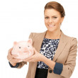 Lovely woman with piggy bank — Stock Photo