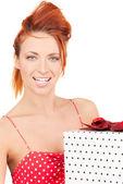 Happy girl with gift box — Stock Photo