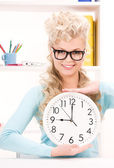 Woman holding big clock — Stock Photo