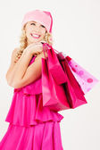 Fröhlich santa helfer mädchen mit einkaufstaschen — Stockfoto