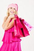 Vrolijke santa helper meisje met shopping tassen — Stockfoto