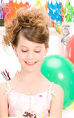 Party girl with cake — Stock Photo