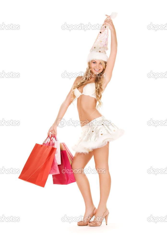 Cheerful santa helper with shopping bags over white — Stock Photo #5497237