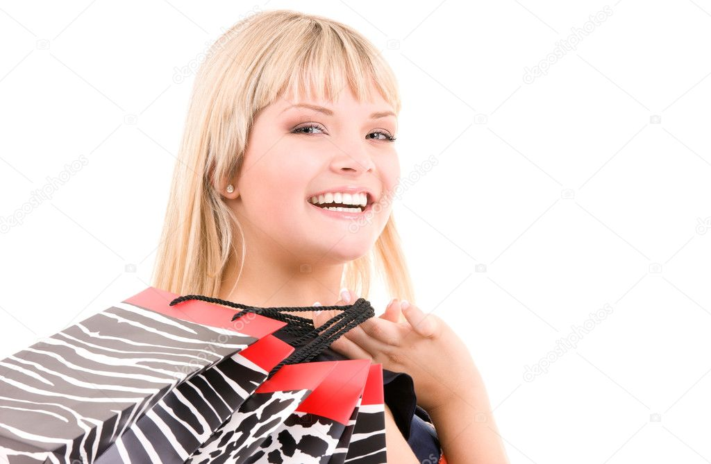 Happy woman with shopping bags over white — Stock Photo #5497312