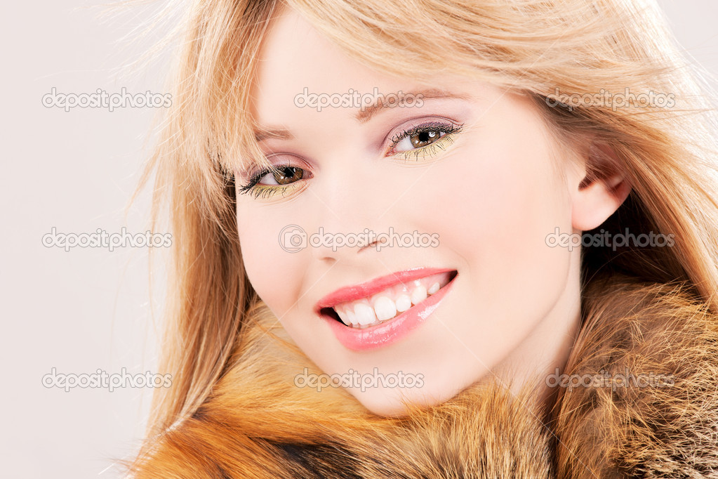 Picture of lovely teenage girl in fur  Stock Photo #5497421