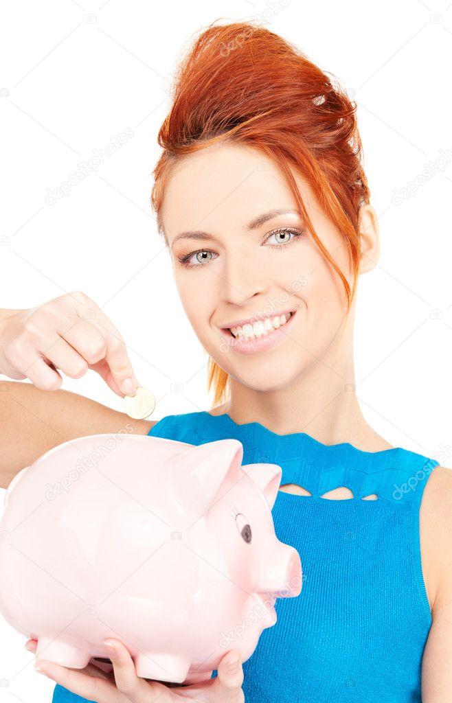 可爱的女人与猪存钱罐