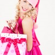 Cheerful santa helper girl with shopping bags — Stock Photo #5501967