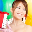 Stock Photo: Party girl with balloons and gift box