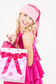 Alegre chica de ayudante de santa con bolsas de compras — Foto de Stock