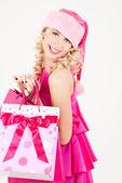 Wesoły pomocnik śnieżynkę z torby na zakupy — Zdjęcie stockowe