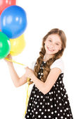 Happy girl with colorful balloons — Stok fotoğraf