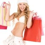 Cheerful santa helper with shopping bags — Stock Photo