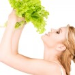 Happy woman with lettuce — Stock Photo #5517547