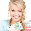 Lovely woman with purse and money — Stock Photo #5517688