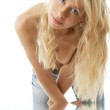 Blonde in blue jeans — Stock Photo