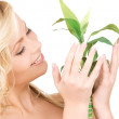 Picture of woman with sprout - Stock Photo