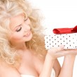 Happy girl with gift box — Stock Photo #5518856