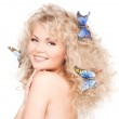 Woman with butterflies in hair — Stock Photo