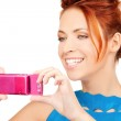 Happy woman using phone camera — Stock Photo