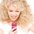 Happy woman with cell phone — Stock Photo #5518931