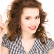 Teenage girl with her finger up - Foto de Stock