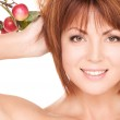 Happy woman with apple twig — Stock Photo #5518983