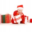 Santa helper baby with christmas gifts — Stock Photo