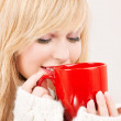 Happy teenage girl with red mug — Stock Photo #5519361
