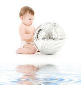 Adorable baby boy with big disco ball — Stock Photo