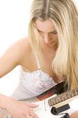 Guitar girl in white lingerie — Stock Photo