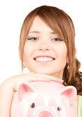 Mooie tiener meisje met piggy bank — Stockfoto