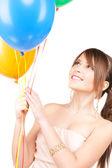 Happy teenage girl with balloons — Stockfoto