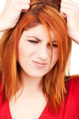Unhappy redhead woman — Photo