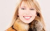 Lovely teenage girl in fur — Stock Photo