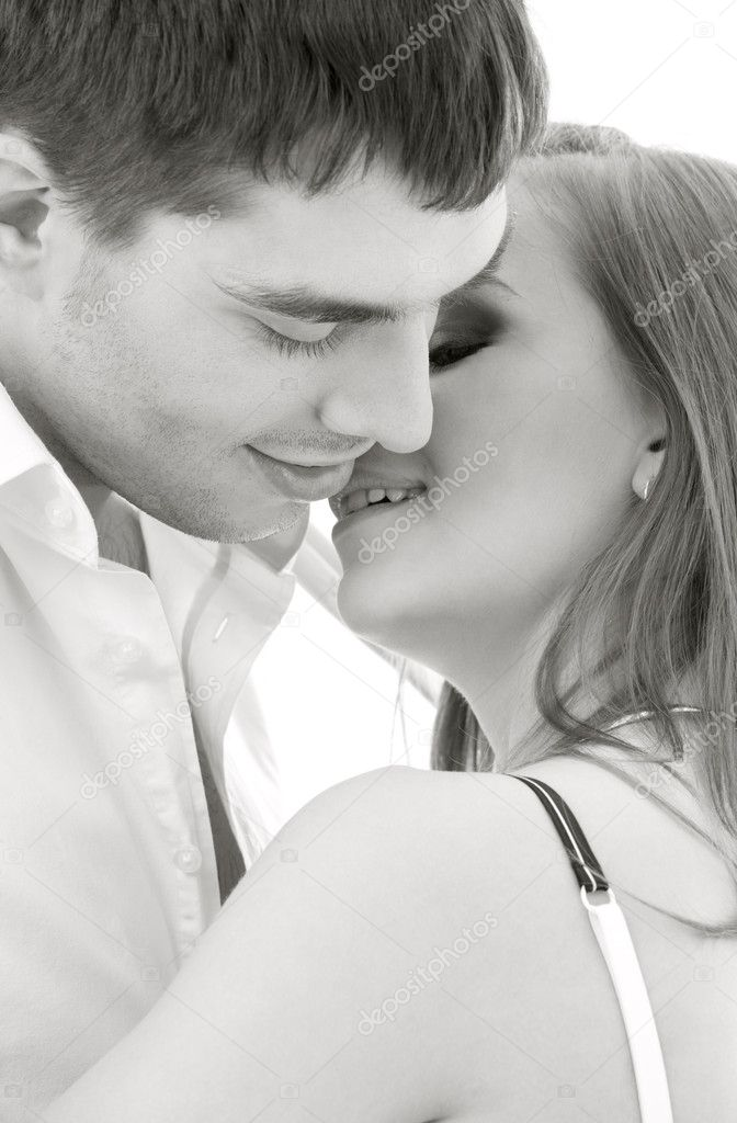 Monochrome picture of couple in love over white  Stock Photo #5517243