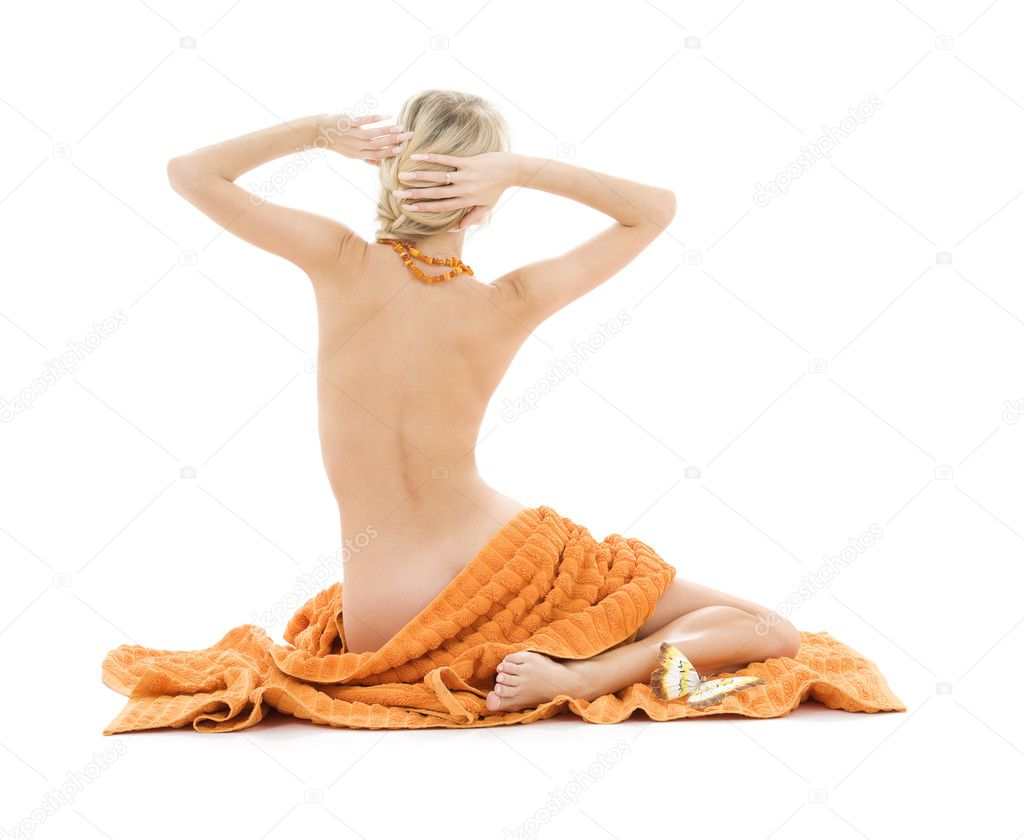 Beautiful lady with orange towels over white — Stock Photo #5518670