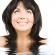 Happy woman looking up in water — Stock Photo #5524661