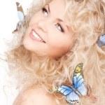 mujer con mariposas en el pelo — Foto de Stock   #5524788